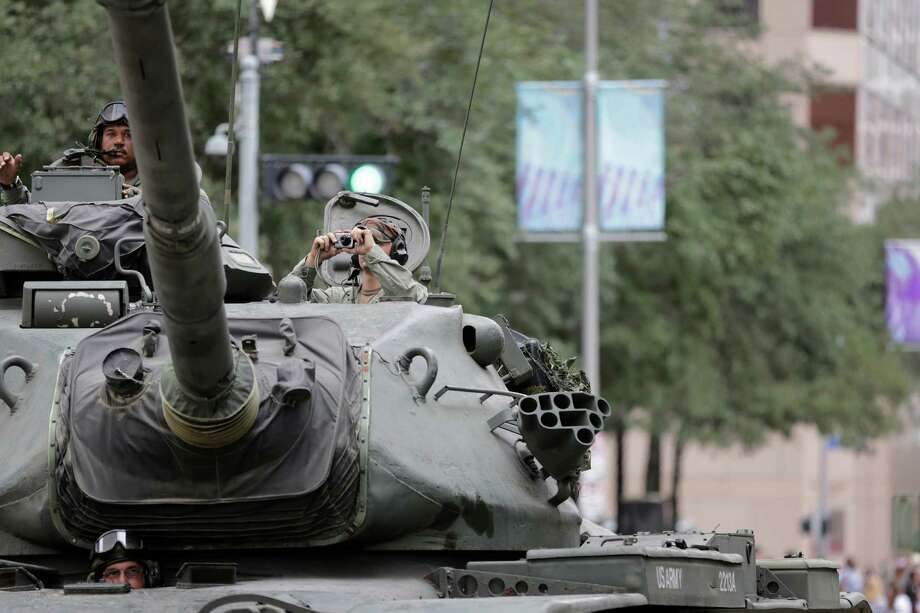 A tank driver takes a break to snap a photo, Sunday, November 11, 2012 during the 2012 Veteran's Day Parade in Downtown Houston, Texas. (TODD SPOTH FOR THE CHRONICLE) Photo: TODD SPOTH, TODD SPOTH / PHOTOGRAPHER / © TODD SPOTH, 2012
