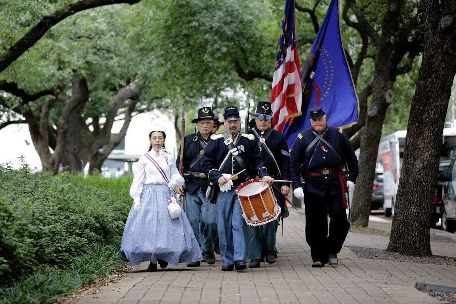 A Civil War reenactment group marches down the sidewalk, Sunday, November 11, 2012 during the 2012 Veteran's Day Parade in Downtown Houston, Texas. (TODD SPOTH FOR THE CHRONICLE) Photo: TODD SPOTH, TODD SPOTH / PHOTOGRAPHER / © TODD SPOTH, 2012