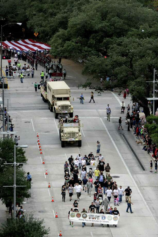 A view of the parade as seen from Lamar Street is seen, Sunday, November 11, 2012 during the 2012 Veteran's Day Parade in Downtown Houston, Texas. (TODD SPOTH FOR THE CHRONICLE) Photo: TODD SPOTH, TODD SPOTH / PHOTOGRAPHER / © TODD SPOTH, 2012