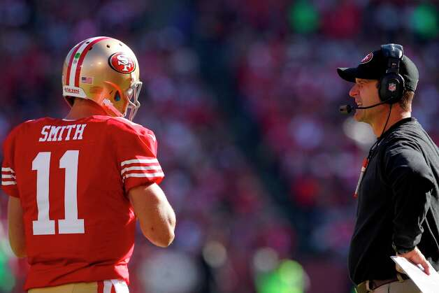 Quarterback Alex Smith (11) and coach Jim Harbaugh during the first quarter of the San Francisco 49ers game against the St. Louis Rams at Candlestick Park in San Francisco, Calif., on Sunday November 11, 2012. Photo: Carlos Avila Gonzalez, The Chronicle / ONLINE_YES