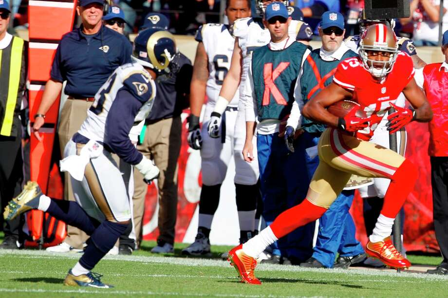 Wide receiver Michael Crabtree (15) runs past St. Louis Rams defensive back Quinton Pointer (33) during the first quarter of the San Francisco 49ers game against the St. Louis Rams at Candlestick Park in San Francisco, Calif., on Sunday November 11, 2012. Photo: Carlos Avila Gonzalez, The Chronicle / ONLINE_YES