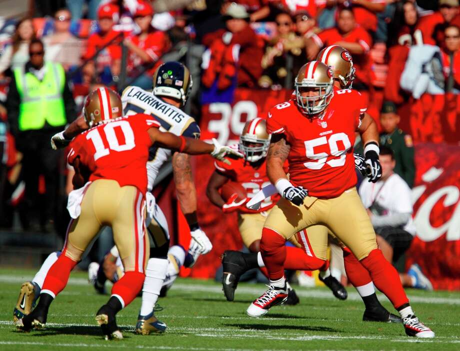 Center Jonathan Goodwin (59) attempts a block for Safety Donte Whitner (31) during the first quarter of the San Francisco 49ers game against the St. Louis Rams at Candlestick Park in San Francisco, Calif., on Sunday November 11, 2012. Photo: Carlos Avila Gonzalez, The Chronicle / ONLINE_YES