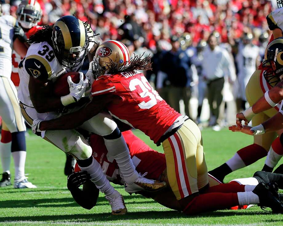 St. Louis Rams running back Steven Jackson carries the ball into the end zone for a touchdown past San Francisco 49ers free safety Dashon Goldson, right, during the first quarter of an NFL football game in San Francisco, Sunday, Nov. 11, 2012. Photo: Marcio Jose Sanchez, Associated Press / AP