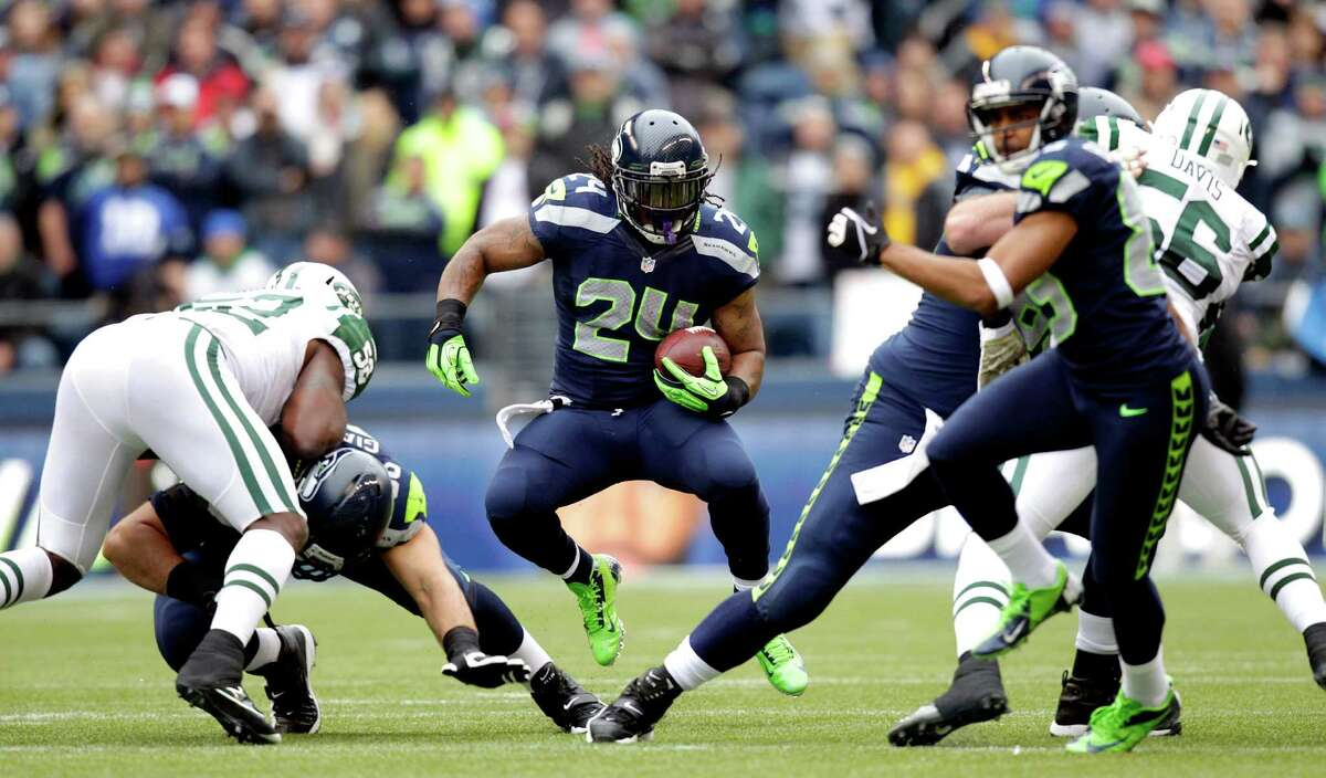 Seattle Seahawks' Marshawn Lynch (24) rushes against the New York Jets during the first half of an NFL football game, Sunday, Nov. 11, 2012, in Seattle.