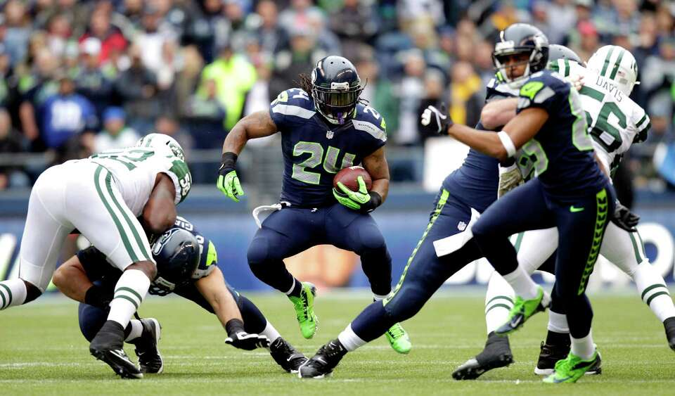 Seattle Seahawks' Marshawn Lynch (24) rushes against the New York Jets during the first half of an N