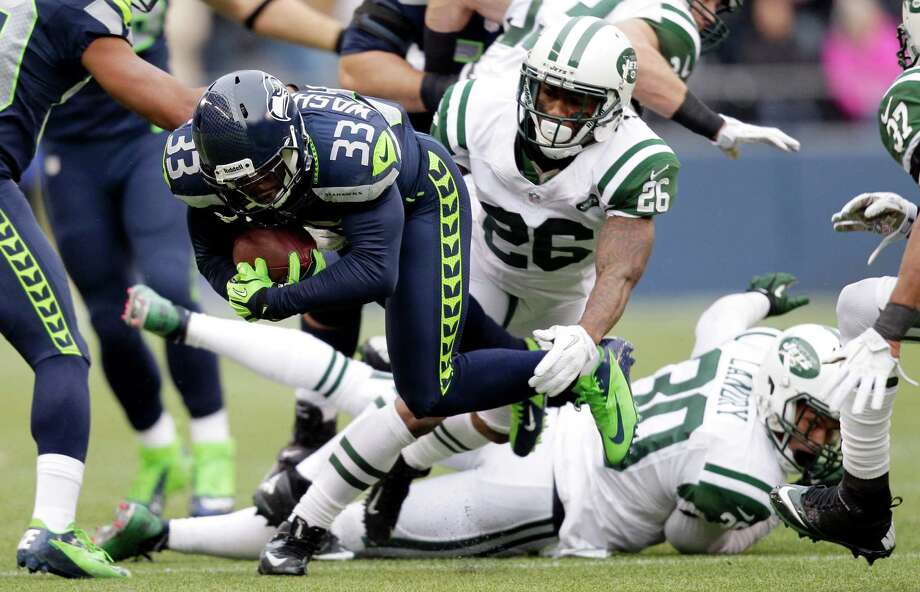 Seattle Seahawks' Leon Washington (33) is tackled by New York Jets' Ellis Lankster (26) during the first half of an NFL football game, Sunday, Nov. 11, 2012, in Seattle. Photo: AP