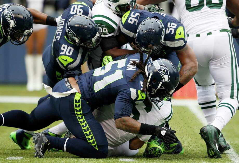 New York Jets quarterback Mark Sanchez is sacked by Seattle Seahawks' Bruce Irvin (51) in the first half of an NFL football game, Sunday, Nov. 11, 2012, in Seattle. Photo: AP