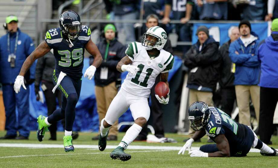 New York Jets' Jeremy Kerley (11) rushes between Seattle Seahawks' Brandon Browner (39) and Kam Chancellor during the first half of an NFL football game, Sunday, Nov. 11, 2012, in Seattle. Photo: AP
