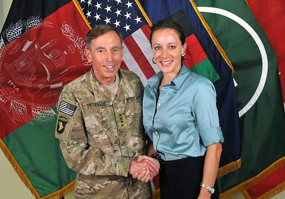 "This July 13, 2011, photo made available on the International Security  Assistance Force's Flickr website shows the former Commander of  International Security Assistance Force and U.S. Forces-Afghanistan Gen.  Davis Petraeus, left, shaking hands with Paula Broadwell, co-author of   ""All In: The Education of General David Petraeus.""As details emerge  about Petraeus' extramarital affair with his biographer, Broadwell,  including a second woman who allegedly received threatening emails from  the author, members of Congress say they want to know exactly when the  now ex-CIA director and retired general popped up in the FBI inquiry,  whether national security was compromised and why they weren't told  sooner. Photo: Associated Press"