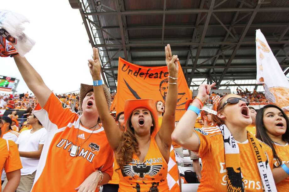 Melissa Hrondka (cq), center, and the rest of the Texian Army cheer for the Dynamo as they play the D.C. United in a  MLS playoff game , Sunday, Nov. 11, 2012,  in BBVA Compass Stadium in Houston. Photo: Nick De La Torre, Houston Chronicle / © 2012  Houston Chronicle