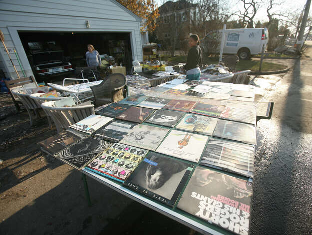 Carla Strobel, left, attempts to dry out her record collection, damaged by flooding from Hurricane Sandy on Fairfield Beach Road in Fairfield on Sunday, November 11, 2012. Photo: Brian A. Pounds / Connecticut Post
