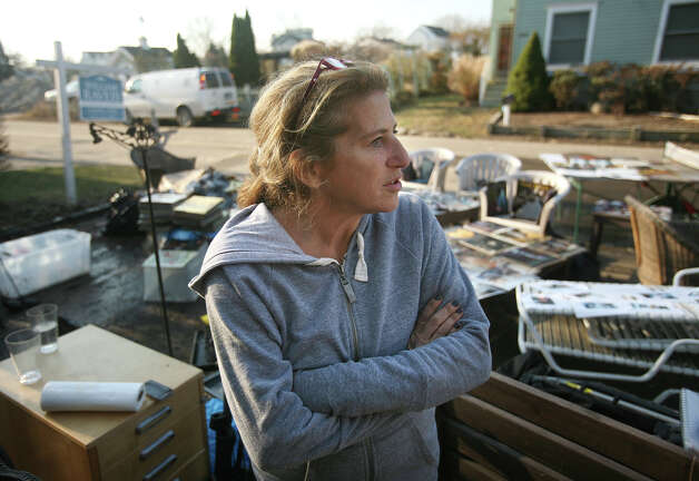 Fairfield Beach Road resident Carla Strobel said she felt lucky, even while attempting to dry out items damaged by flooding from Hurricane Sandy in Fairfield on Sunday, November 11, 2012. Photo: Brian A. Pounds / Connecticut Post