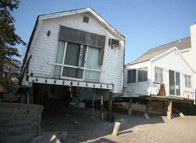 Damaged homes in the wake of Hurricane Sandy on Fairfield Beach Road in Fairfield on Sunday, November 11, 2012. Photo: Brian A. Pounds / Connecticut Post