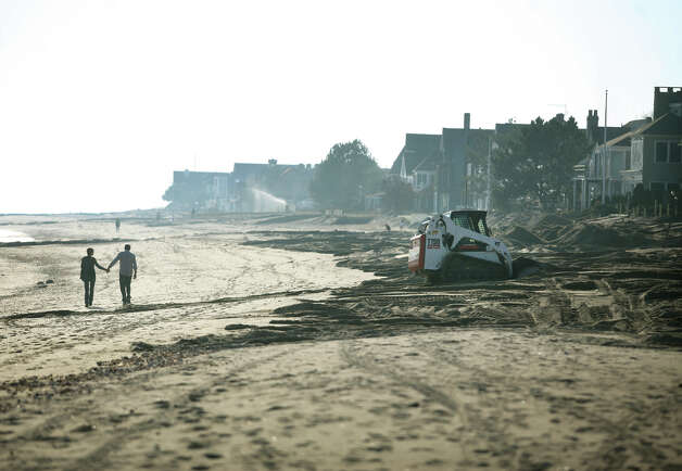 Clean up continues in the wake of Hurricane Sandy on Fairfield Beach Road in Fairfield on Sunday, November 11, 2012. Photo: Brian A. Pounds / Connecticut Post