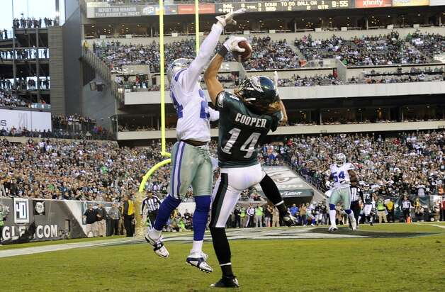 Philadelphia Eagles wide receiver Riley Cooper, right, pulls in a touchdown pass as Dallas Cowboys cornerback Morris Claiborne defends in the first half of an NFL football game, Sunday, Nov. 11, 2012, in Philadelphia. (AP Photo/Michael Perez) (Associated Press)