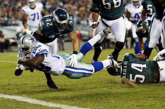 Dallas Cowboys running back Felix Jones (28) dives for a touchdown as Philadelphia Eagles free safety Kurt Coleman (42) and defensive end Brandon Graham (54) defend in the first half of an NFL football game, Sunday, Nov. 11, 2012, in Philadelphia. (AP Photo/Julio Cortez) (Associated Press)