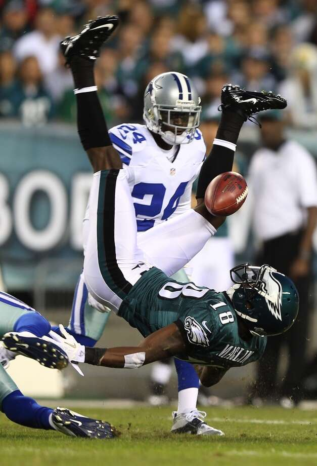 Jeremy Maclin #18 of the Philadelphia Eagles cannot hang on to the ball as he is hit by Charlie Peprah #26 and Morris Claiborne #24 of the Dallas Cowboys on November 11, 2012 at Lincoln Financial Field in Philadelphia, Pennsylvania.  (Photo by Elsa/Getty Images) (Getty Images)