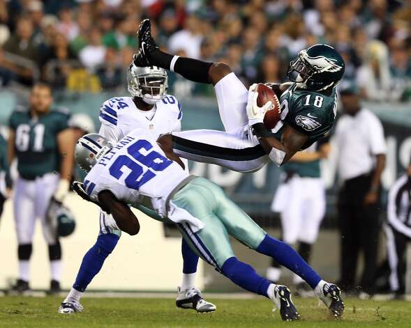 Jeremy Maclin #18 of the Philadelphia Eagles jumps up for the catch but does not hang on to the ball as he is hit by Charlie Peprah #26 of the Dallas Cowboys on November 11, 2012 at Lincoln Financial Field in Philadelphia, Pennsylvania.  (Photo by Elsa/Getty Images) (Getty Images)
