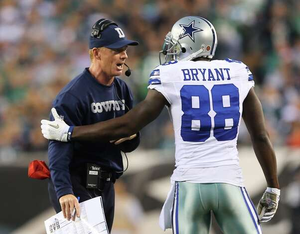 Head coach Jason Garrett of the Dallas Cowboys talks with  Dez Bryant (88) in the first quarter against the Philadelphia Eagles on November 11, 2012 at Lincoln Financial Field in Philadelphia.  Elsa/Getty Images