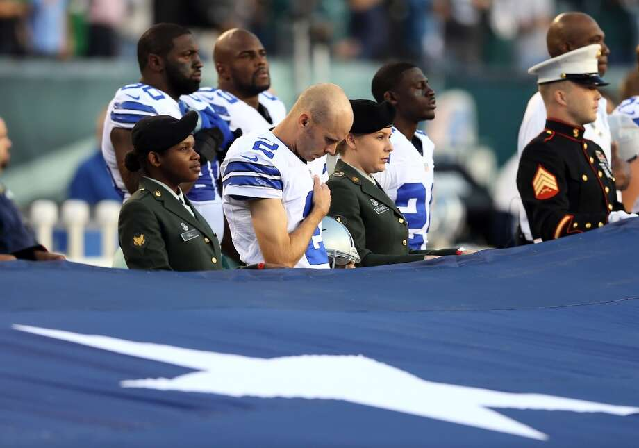 Brian Moorman #2 of the Dallas Cowboys listens to the national anthem as a giant flag covers the field before the game against the Philadelphia Eagles on November 11, 2012 at Lincoln Financial Field in Philadelphia, Pennsylvania.  (Photo by Elsa/Getty Images) (Getty Images)