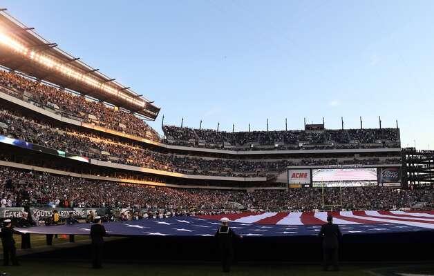 A Giant flag covers the field as the national anthem is played before the game between the Philadelphia Eagles and the Dallas Cowboys on November 11, 2012 at Lincoln Financial Field in Philadelphia, Pennsylvania.  (Photo by Elsa/Getty Images) (Getty Images)