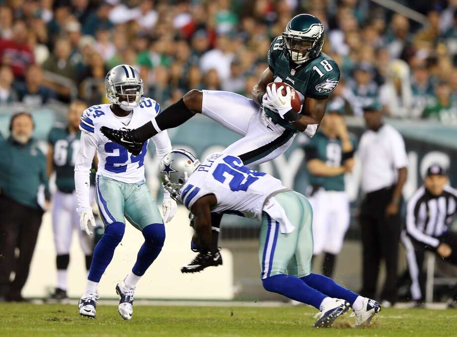 Jeremy Maclin #18 of the Philadelphia Eagles goes up for the catch but does not hang on to the ball as he is hit by Charlie Peprah #26 of the Dallas Cowboys on November 11, 2012 at Lincoln Financial Field in Philadelphia, Pennsylvania.  (Photo by Elsa/Getty Images) (Getty Images)
