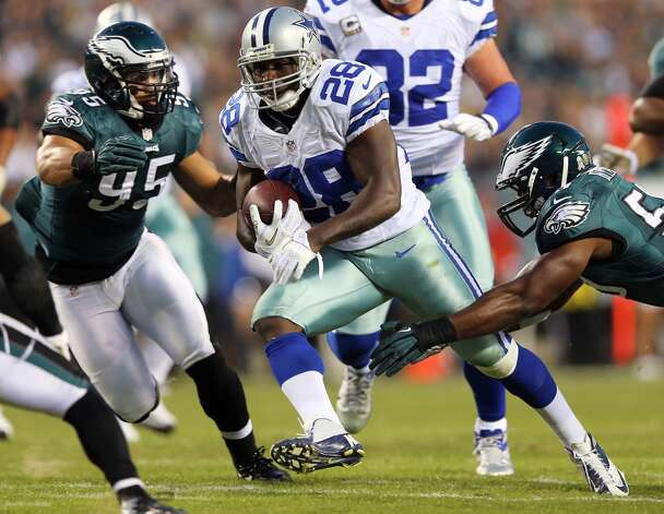 Felix Jones #28 of the Dallas Cowboys carries the ball as  Mychal Kendricks #95 and  DeMeco Ryans #59 of the Philadelphia Eagles defend on November 11, 2012 at Lincoln Financial Field in Philadelphia, Pennsylvania.  (Photo by Elsa/Getty Images) (Getty Images)