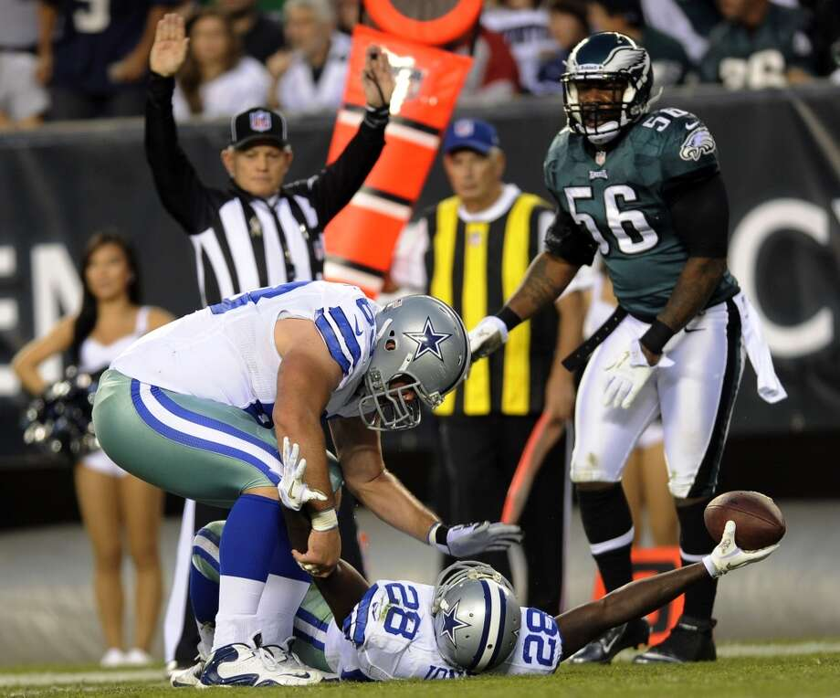 Dallas Cowboys running back Felix Jones, bottom, celebrates with center Ryan Cook, left, as Philadelphia Eagles outside linebacker Akeem Jordan watches after Jones' scored a touchdown in the first half of an NFL football game, Sunday, Nov. 11, 2012, in Philadelphia. (AP Photo/Michael Perez) (Associated Press)