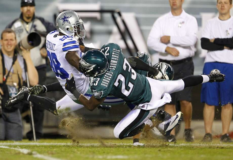 Wide receiver Dez Bryant #88 of the Dallas Cowboys is tackled after making a catch by Dominique Rodgers-Cromartie #23 of the Philadelphia Eagles during the first half of a game at Lincoln Financial Field on November 11, 2012 in Philadelphia, Pennsylvania. (Photo by Rich Schultz /Getty Images) (Getty Images)