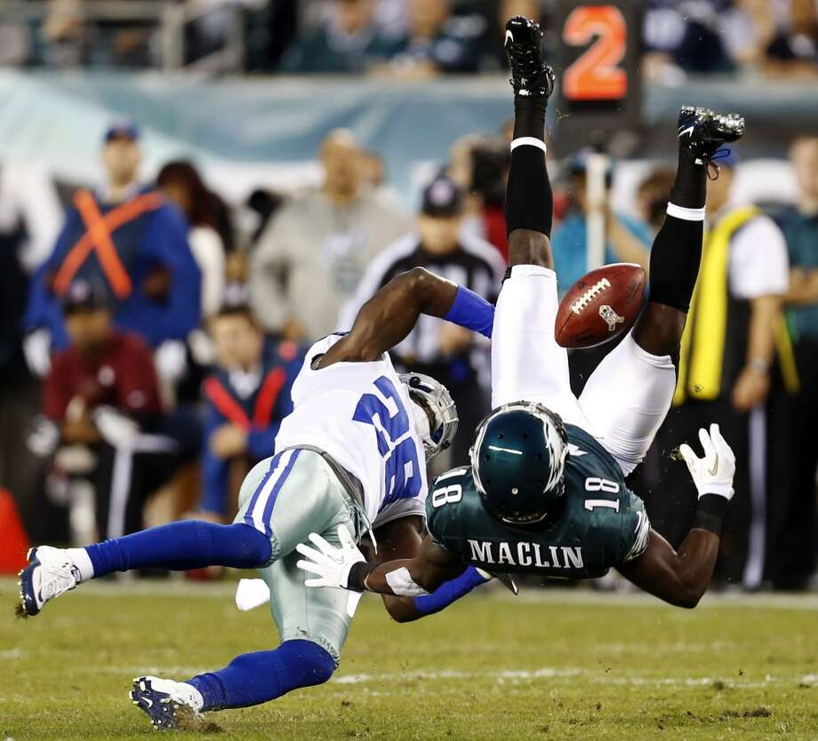 Dallas Cowboys defensive back Charlie Peprah, left, breaks up a pass intended for Philadelphia Eagles wide receiver Jeremy Maclin in the first half of an NFL football game, Sunday, Nov. 11, 2012, in Philadelphia. (AP Photo/Julio Cortez) (Associated Press)