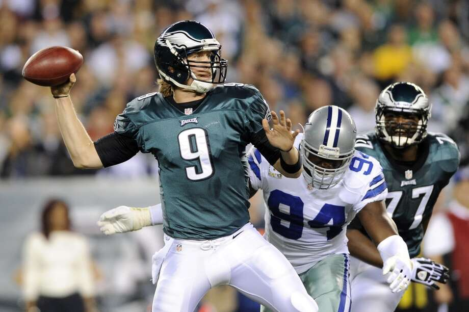 Philadelphia Eagles quarterback Nick Foles, left, passes as Dallas Cowboys outside linebacker DeMarcus Ware pressures in the first half of an NFL football game, Sunday, Nov. 11, 2012, in Philadelphia. (AP Photo/Michael Perez) (Associated Press)