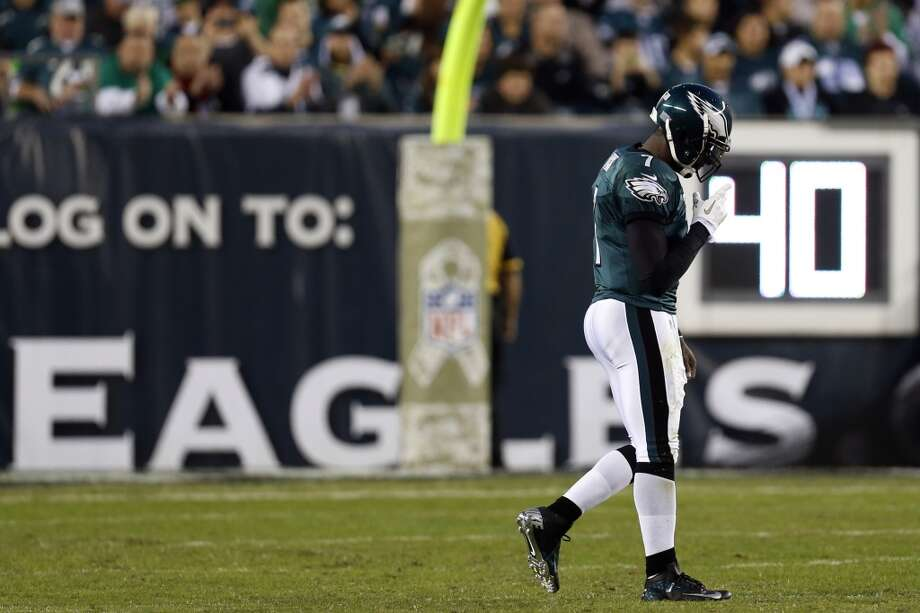 Philadelphia Eagles quarterback Michael Vick walks towards the sidelines in the first half of an NFL football game against the Dallas Cowboys, Sunday, Nov. 11, 2012, in Philadelphia. (AP Photo/Julio Cortez) (Associated Press)