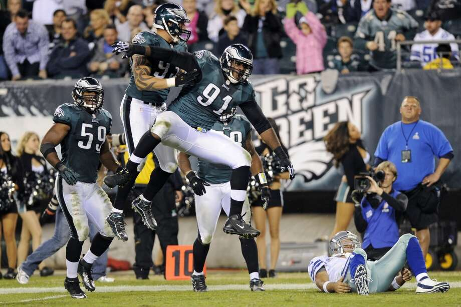 Philadelphia Eagles' Fletcher Cox (91), Jason Babin (93) and DeMeco Ryans (59) react after sacking Dallas Cowboys quarterback Tony Romo in the second half of an NFL football game, Sunday, Nov. 11, 2012, in Philadelphia. (AP Photo/Michael Perez) (Associated Press)