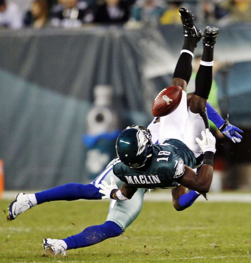 Dallas Cowboys defensive back Charlie Peprah, left, breaks up a pass intended for Philadelphia Eagles wide receiver Jeremy Maclin in the first half of an NFL football game, Sunday, Nov. 11, 2012, in Philadelphia. (AP Photo/The Philadelphia Inquirer, Ron Cortes)  PHIX OUT; TV OUT; MAGS OUT; NEWARK OUT (Associated Press)
