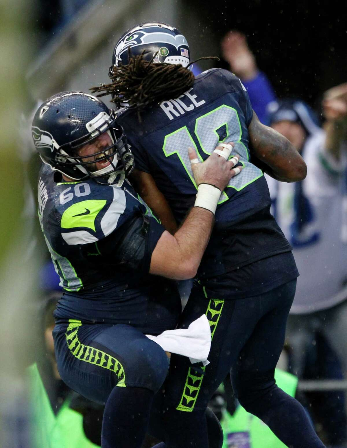 Seattle Seahawks' Sidney Rice (18) celebrates his touchdown with teammate Max Unger (60) during the second half of an NFL football game against the New York Jets, Sunday, Nov. 11, 2012, in Seattle.