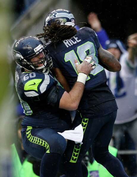 Seattle Seahawks' Sidney Rice (18) celebrates his touchdown with teammate Max Unger (60) during the