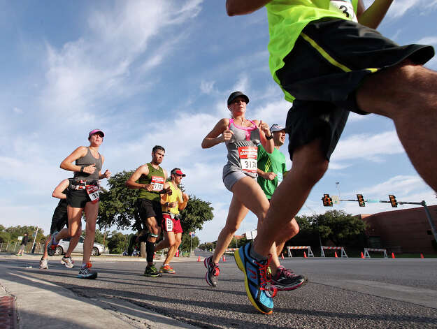 Participants take part in the Rock 'n' Roll San Antonio Marathon and 1/2 Marathon Sunday Nov. 11, 2012. Photo: Edward A. Ornelas, San Antonio Express-News / © 2012 San Antonio Express-News