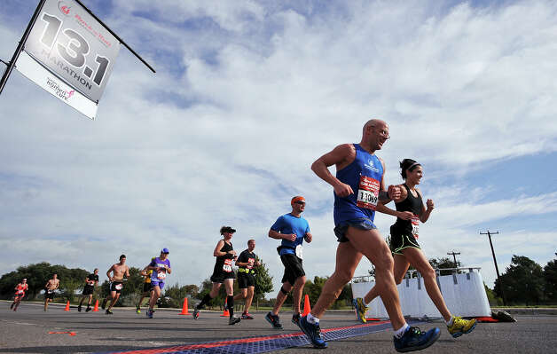 Marathon runners cross the 13.1-mile marker during the Rock 'n' Roll San Antonio Marathon and 1/2 Marathon Sunday Nov. 11, 2012. Photo: Edward A. Ornelas, San Antonio Express-News / © 2012 San Antonio Express-News