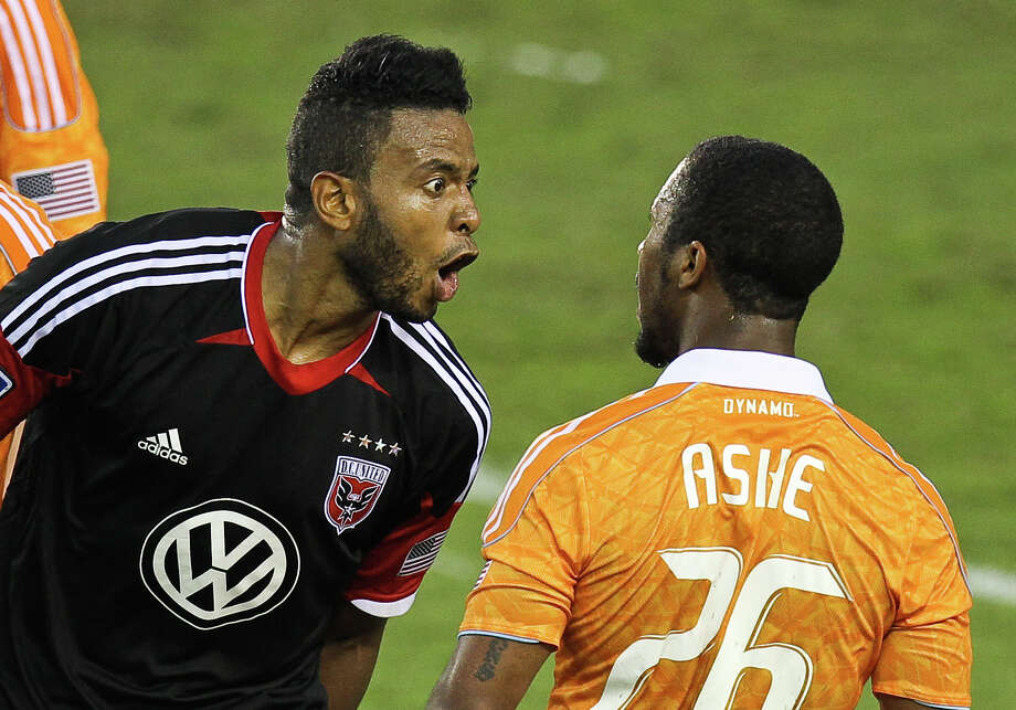 Lionard Pajoy #26 yells at Corey Ashe #26 of the Houston Dynamo after a foul wasn't called during the second half of a MLS playoff game , Sunday, Nov. 11, 2012,  in BBVA Compass Stadium in Houston. Photo: Nick De La Torre, Houston Chronicle / © 2012  Houston Chronicle