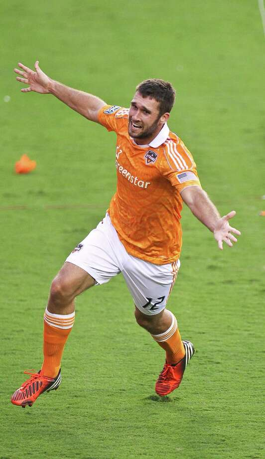 Will Bruin #12 of the Houston Dynamo celebrates his go ahead goal during the second half of a MLS playoff game against the D.C. United, Sunday, Nov. 11, 2012,  in BBVA Compass Stadium in Houston.  Houston Dynamo won 3-0. Photo: Nick De La Torre, Houston Chronicle / © 2012  Houston Chronicle