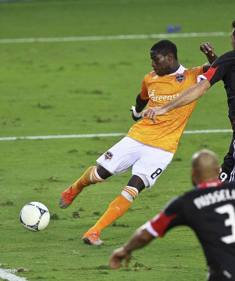 Kofi Sarkodie #8 of the Houston Dynamo scores the Dynamo's third goal during the second half of a MLS playoff game, Sunday, Nov. 11, 2012,  in BBVA Compass Stadium in Houston. Photo: Nick De La Torre, Houston Chronicle / © 2012  Houston Chronicle