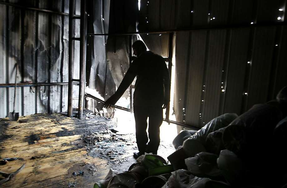 A Palestinian stands in a factory hit by an Israeli tank shell in Beit Hanoun, northern Gaza Strip, Sunday, Nov. 11, 2012. Hostilities along the Gaza-Israel border escalated sharply over the weekend, with bombardments from Gaza causing rare Israeli casualties and Israeli strikes killing at least six Palestinians. (AP Photo/Hatem Moussa) Photo: Hatem Moussa, Associated Press