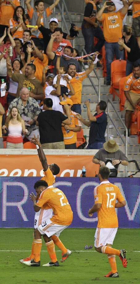 Kofi Sarkodie #8 of the Houston Dynamo celebrates with his teammates after scoring the Dynamo's third goal during the second half of a MLS playoff game, Sunday, Nov. 11, 2012,  in BBVA Compass Stadium in Houston. Photo: Nick De La Torre, Houston Chronicle / © 2012  Houston Chronicle