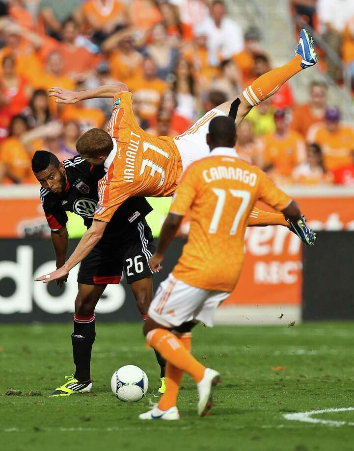 Lionard Pajoy #26 and Andre Hainault #31 of the Houston Dynamo collide during the first half of a MLS playoff game , Sunday, Nov. 11, 2012,  in BBVA Compass Stadium in Houston. Photo: Nick De La Torre, Houston Chronicle / © 2012  Houston Chronicle