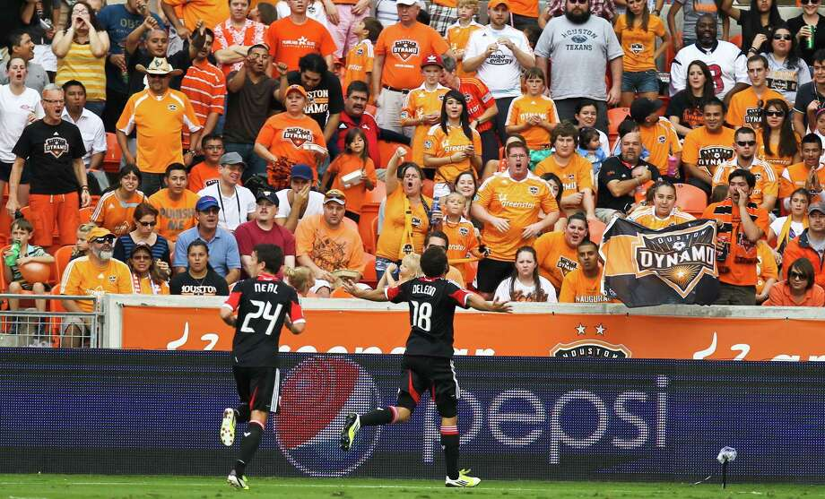 D.C. United midfielder Nick DeLeon celebrates his goal with Dynamo fans firing the first half of a MLS playoff game , Sunday, Nov. 11, 2012,  in BBVA Compass Stadium in Houston. Photo: Nick De La Torre, Houston Chronicle / © 2012  Houston Chronicle