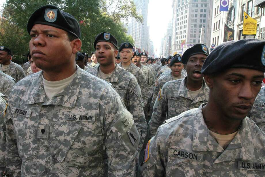 Members of the U.S. Army Reserves do cadence as they wait to march up New York's Fifth Avenue in the Veterans Day Parade Sunday Nov. 11, 2012.   (AP Photo/Tina Fineberg) Photo: Tina Fineberg