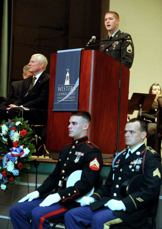 Derek B. Roy,staff sergeant with the Connecticut Army National Guard who is currently working on his MBA at Western Connecticut State University, speaks during the University's Veterans Day program Friday, Nov. 9, 2012. Seated in front are, David Curtis, 23, of Bethel, right, who is in the Marine Corps., and John Cummings, 26, with the Army National Guard. Photo: Carol Kaliff / The News-Times