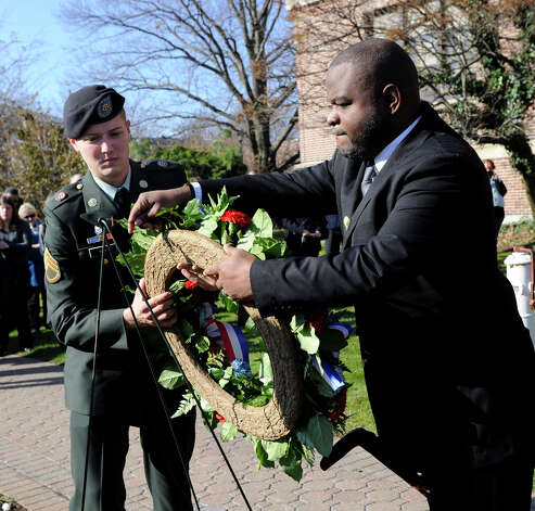 Derek B. Roy, left, and Darnell Carpenter, members of the U.S. Military and students at Western Connecticut State University, place a wreath during the university's Veterans Day ceremony, Friday, Nov. 9, 2012. Photo: Carol Kaliff / The News-Times