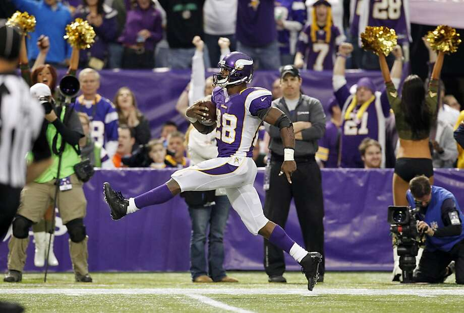Adrian Peterson skips toward the end zone on his game-sealing 61-yard touchdown run as he continued his recovery from reconstructive knee surgery. Photo: Genevieve Ross, Associated Press