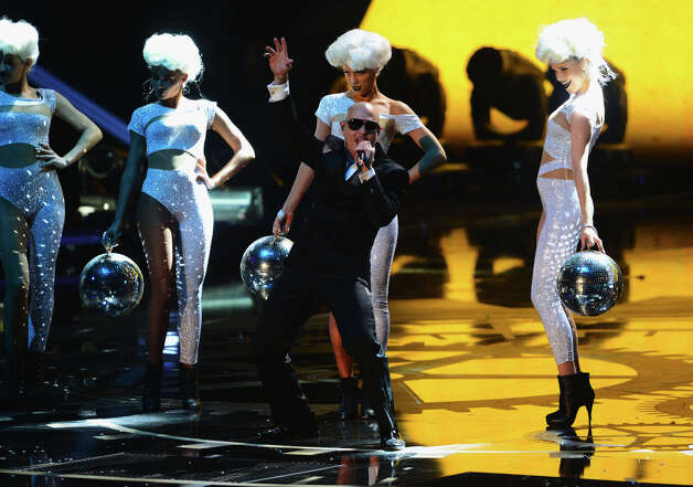 Pitbull performs onstage during the MTV EMA's 2012 at Festhalle Frankfurt on November 11, 2012 in Frankfurt am Main, Germany. Photo: Ian Gavan, Getty Images For MTV / 2012 Getty Images